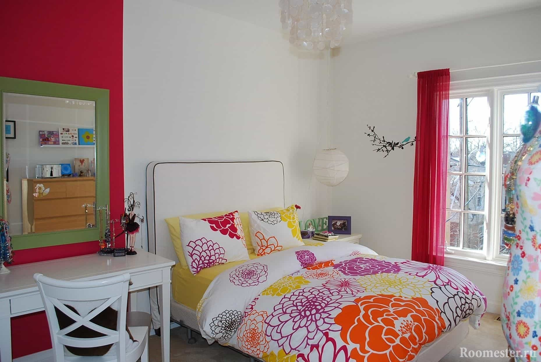 In the white room of a teenage girl - colored bedding and decorative elements.