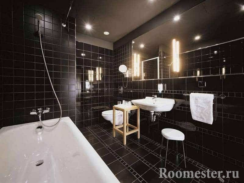 Bathroom in black tiles combined with toilet