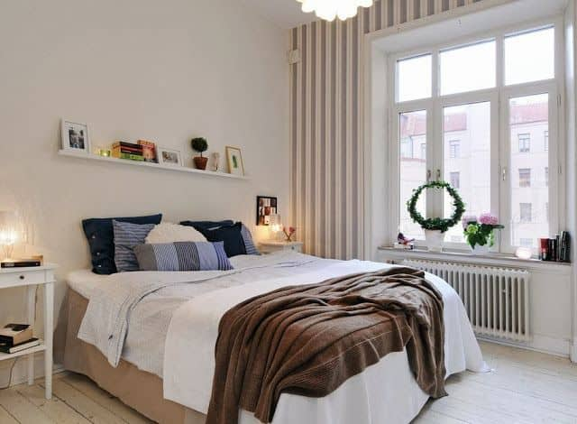 Bright bedroom 4 by 4 meters with a large window