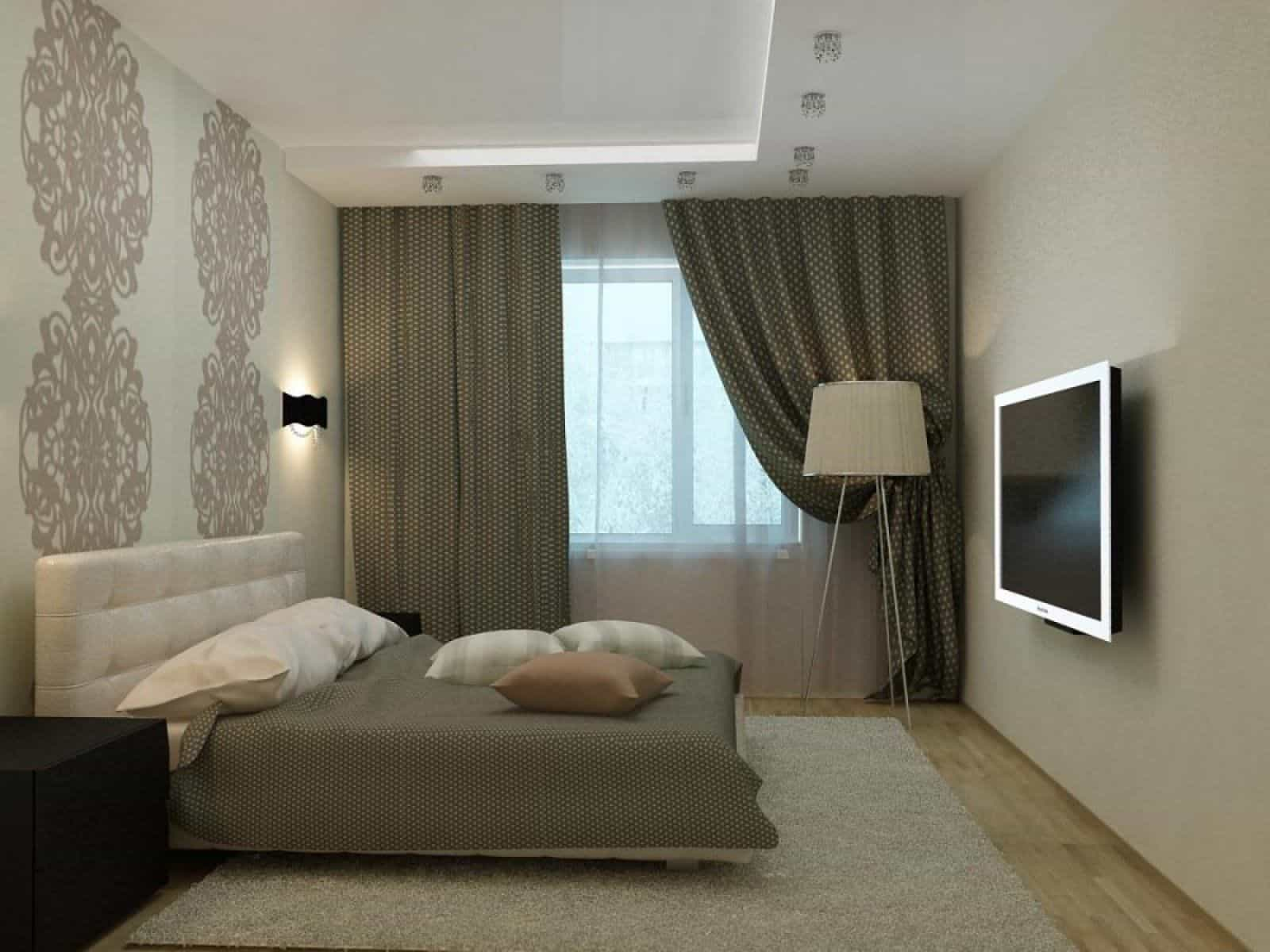 Spotlights on the ceiling and sconces on the wall in the bedroom