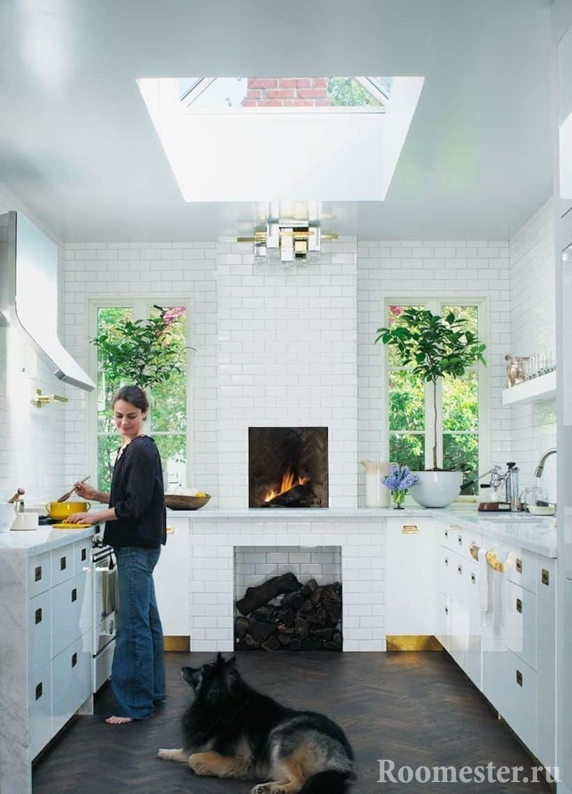 Elongated kitchen in a private house with a stove and a window in the ceiling