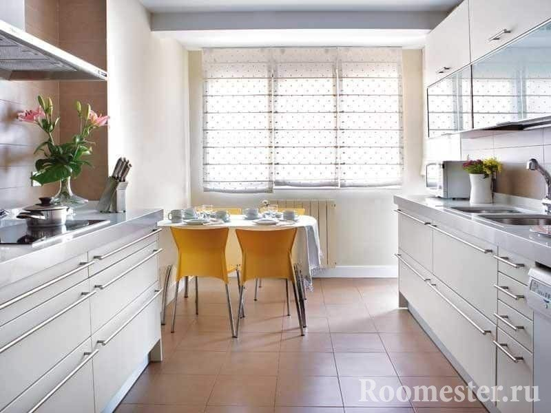 Design of an elongated kitchen of 12 square meters with a window