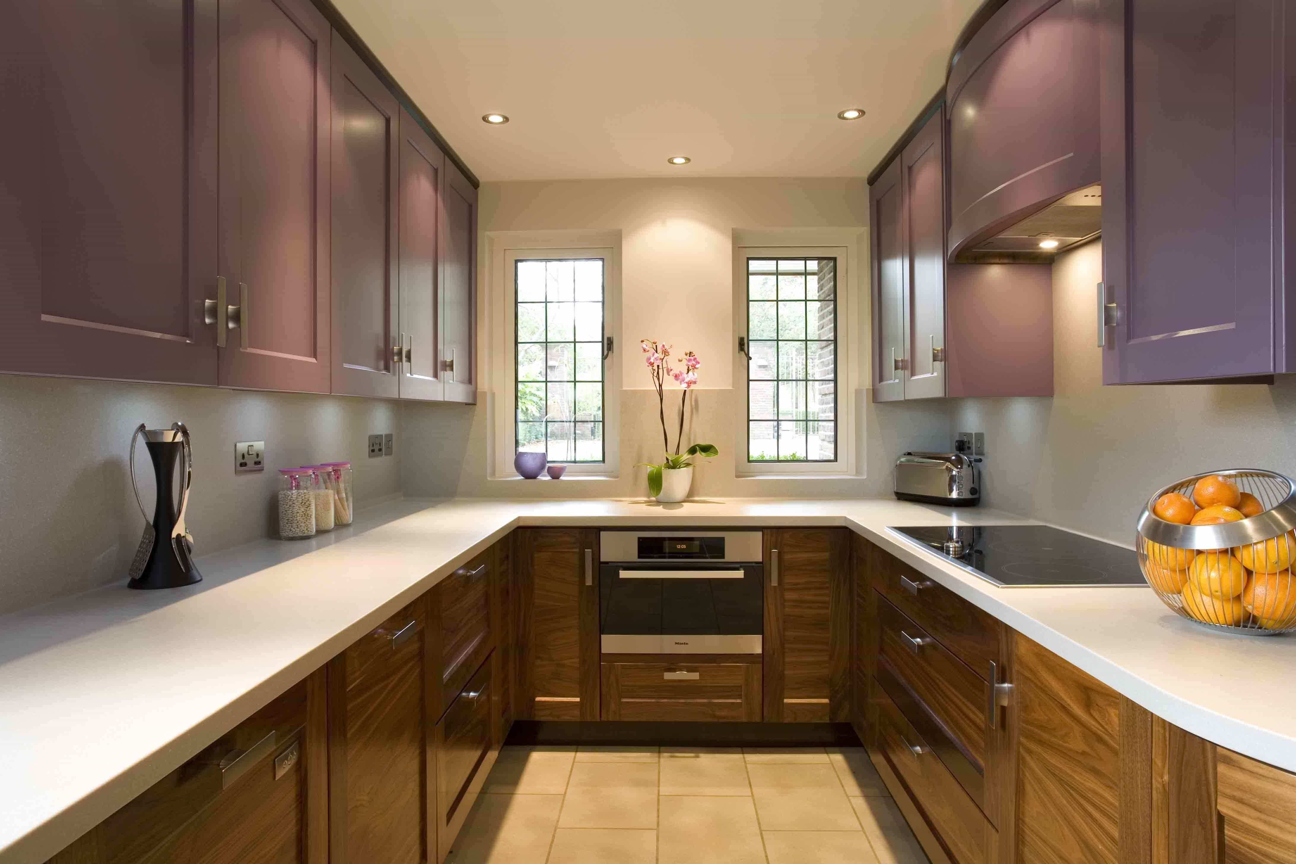 U-shaped kitchen in lilac color in combination with wood