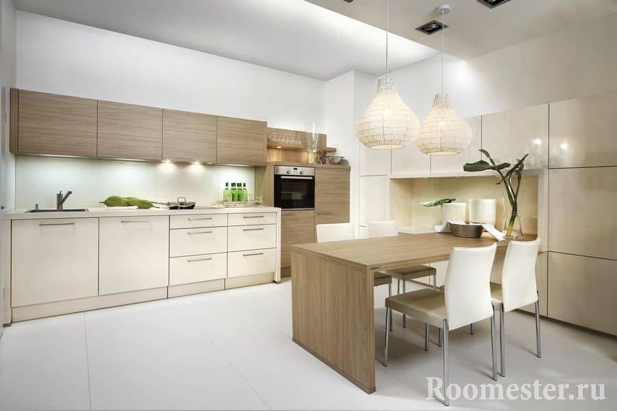 Современный дизайн кухни в светлых тонах с обеденной зоной
