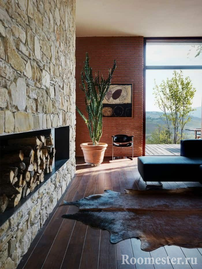 Decorating the fireplace wall with artificial stone