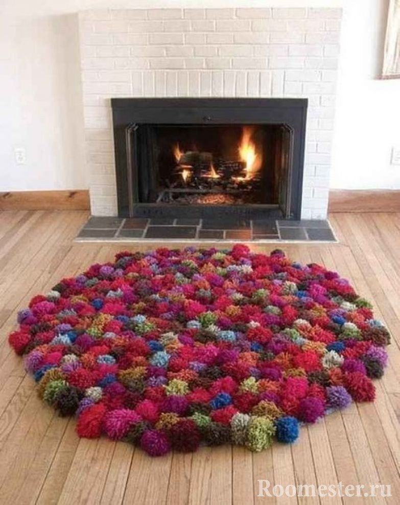 Multi-colored rug made of pompons