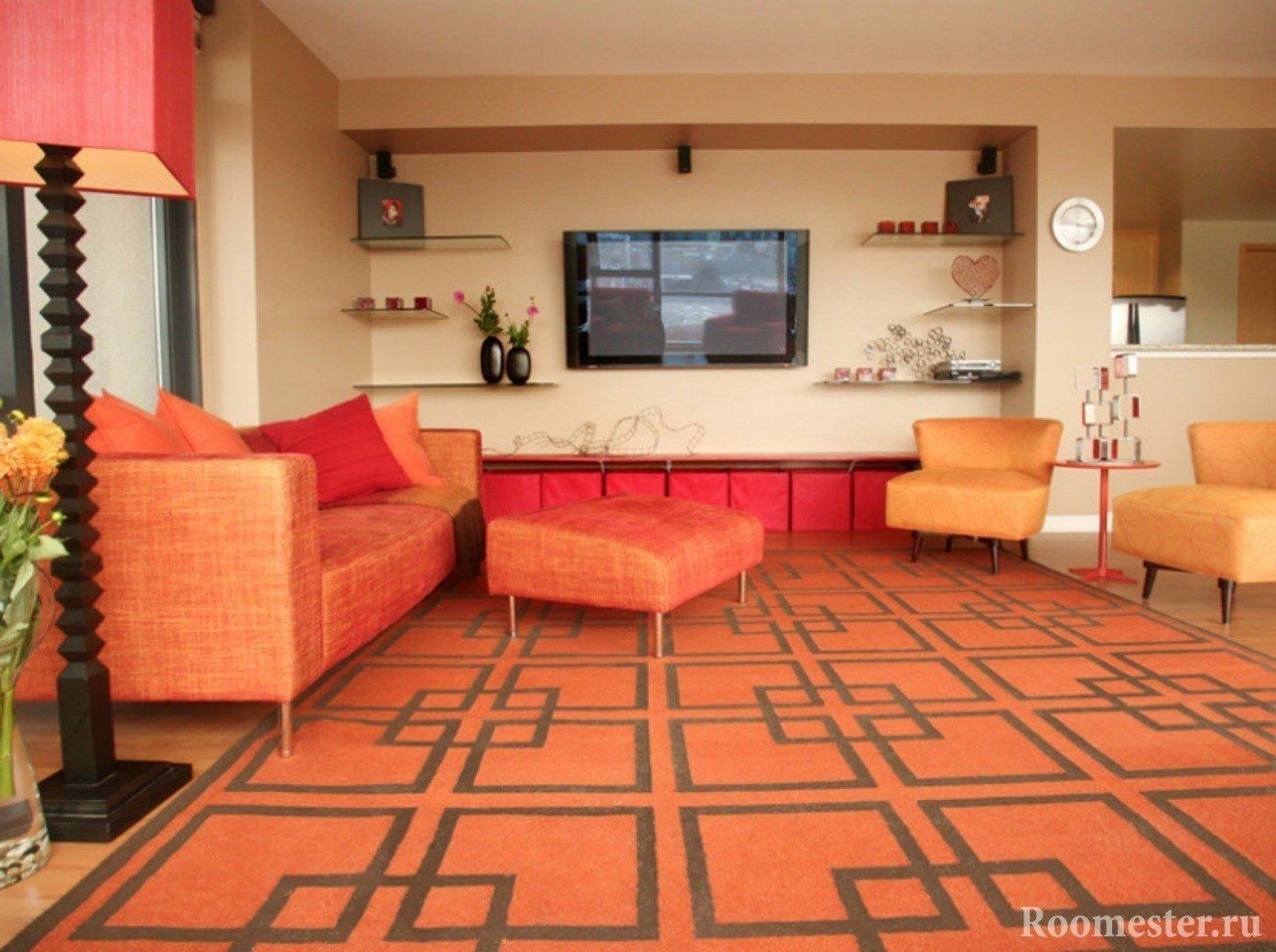 Оранжевый ковер и мебель