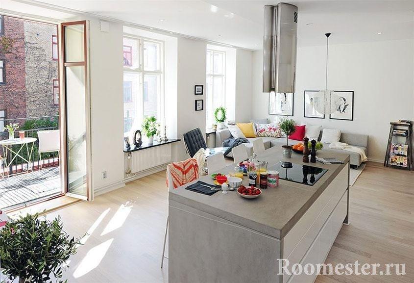 Гостиная с островом-кухней в комнате