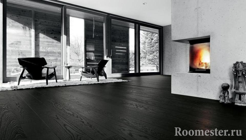 Black laminate floor in the living room with fireplace.