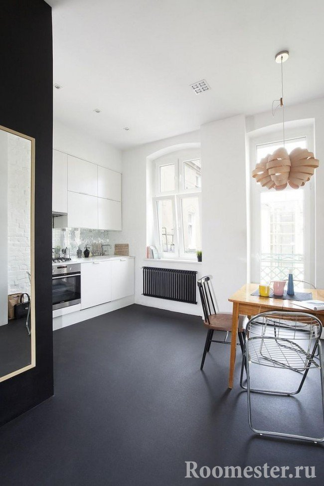 Dark floor in the bright kitchen