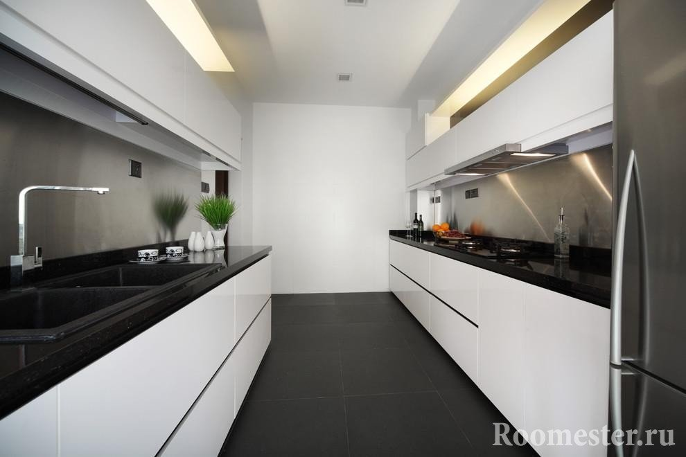 Narrow and long white kitchen with black floor