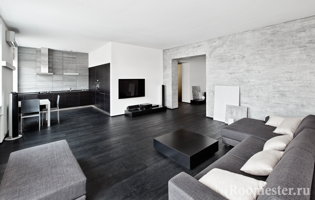 Dark floor in the interior of a studio apartment