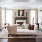 Белая мебель и картина над камином