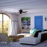 Белые диваны и столик напортив балкона