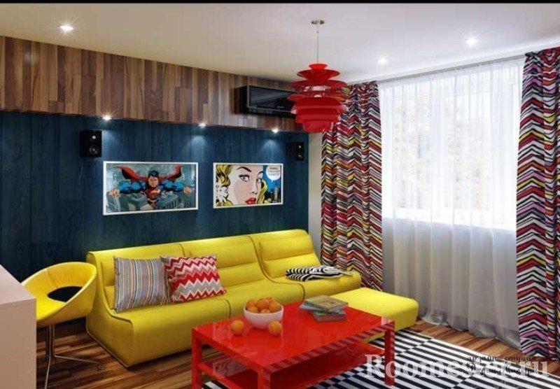 Сочетание желтой и красной мебели в комнате