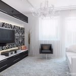 Белый диван и черное кресло в гостиной