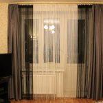 Черно-белые нитяные шторы в гостиной