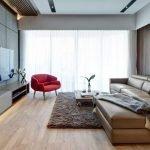 Интерьер гостиной с диваном и креслом