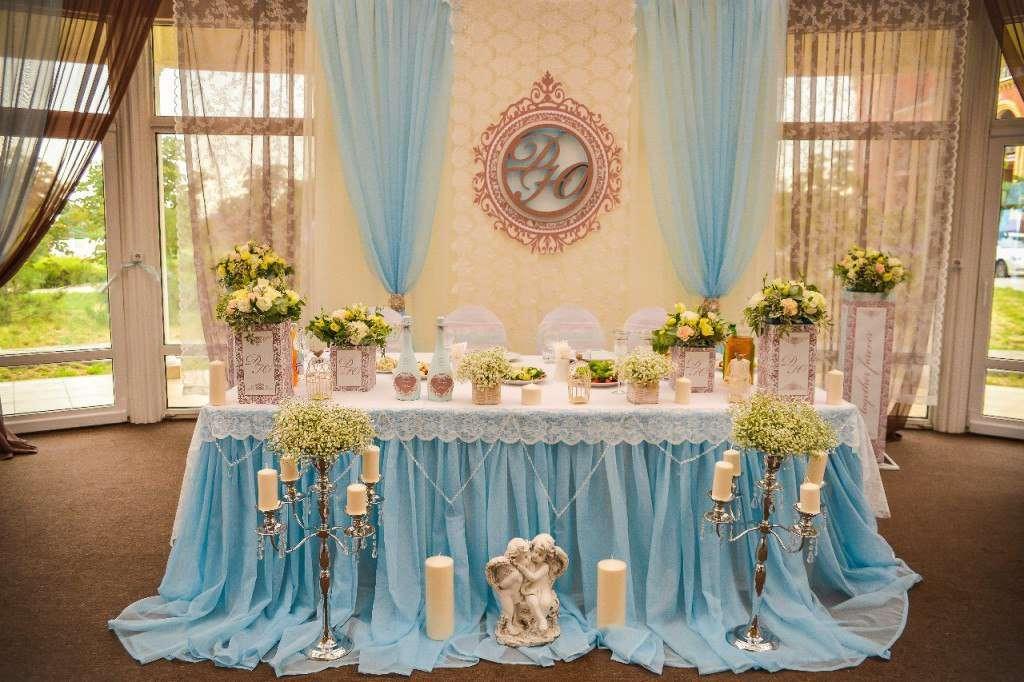 Ангелы и свечи у свадебного стола