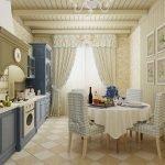 Бежевый интерьер кухни с синей мебелью