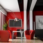 Белый стол и красные стулья в столовой