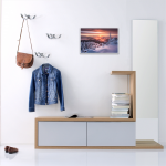 Вешалки и зеркало на стене