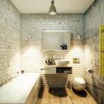 Желтый сушитель для полотенец в серой ванной