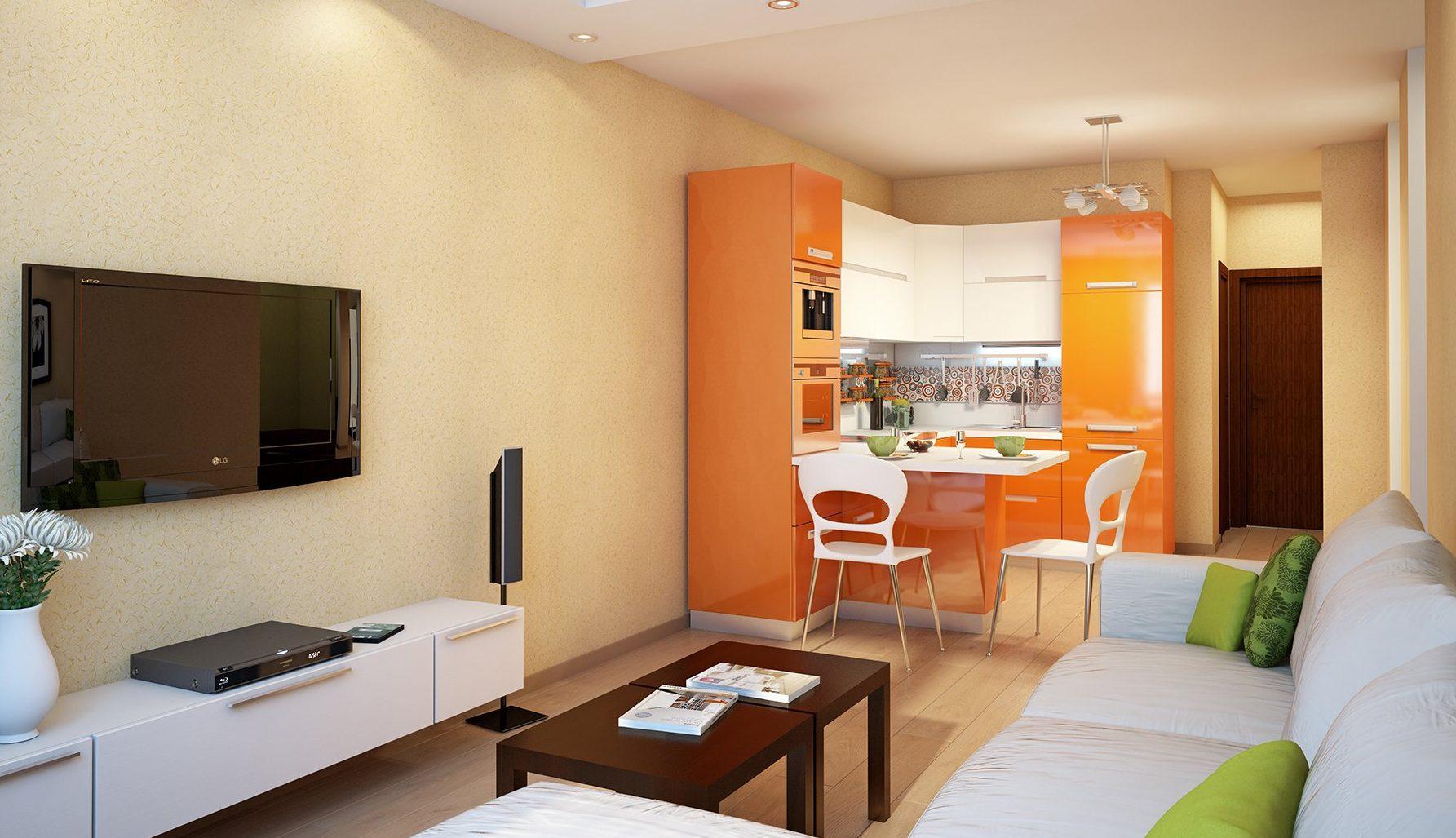 Оранжевый кухонный гарнитур в квартире-студии