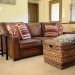 Коричневый диван из экокожи
