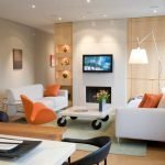 White sofas and an orange armchair in the living room