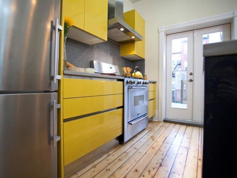 Применение желтого цвета в интерьере кухни