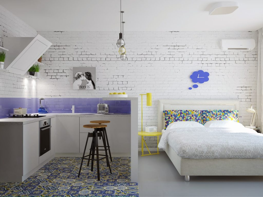 Яркие акценты в белоснежном интерьере квартиры-студии