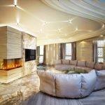 Полукруглый диван напротив декоративного камина