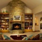 Шкафы с книгами возле камина