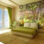 Фотообои в дизайне зеленой спальни