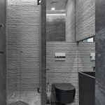 Gray textured tiles in the decoration of the toilet