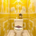 Yellow tile with white ornament in the toilet