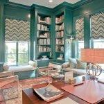 Книжные шкафы у окна