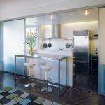 Стальной холодильник в интерьере