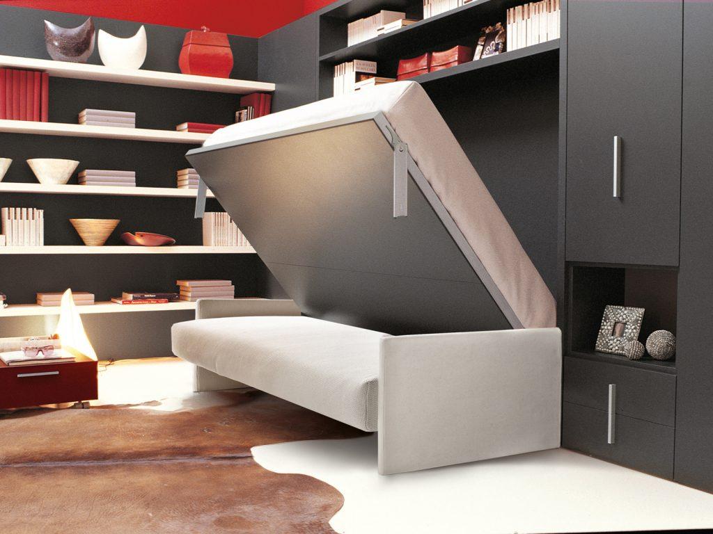 Белая кровать-трансформер в гостиной с темной мебелью