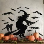 Кошка и ведьма на метле