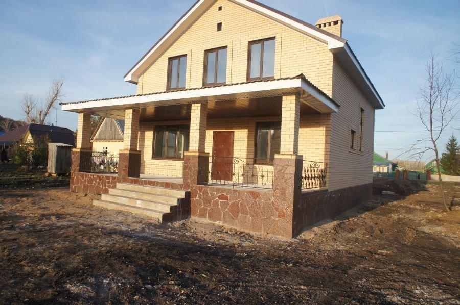 Дом с террасой из кирпича