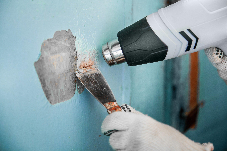 Удаление старой краски со стен