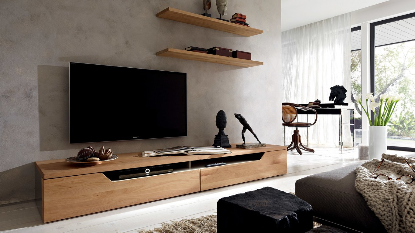 Телевизор над тумбой