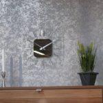 Часы над комодом