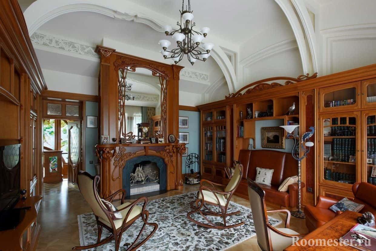 Комната отдыха с книжными шкафами и камином в стиле модерн