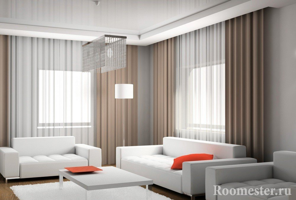 Строгий стиль комнаты с ярко-красными элементами декора