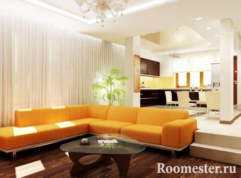 Оранжевый угловой диван в интерьере