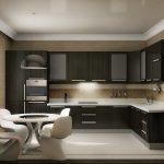 Темная мебель и белый стол со стульями на кухне