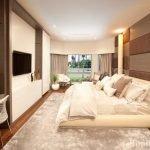 Телевизор на стене спальни